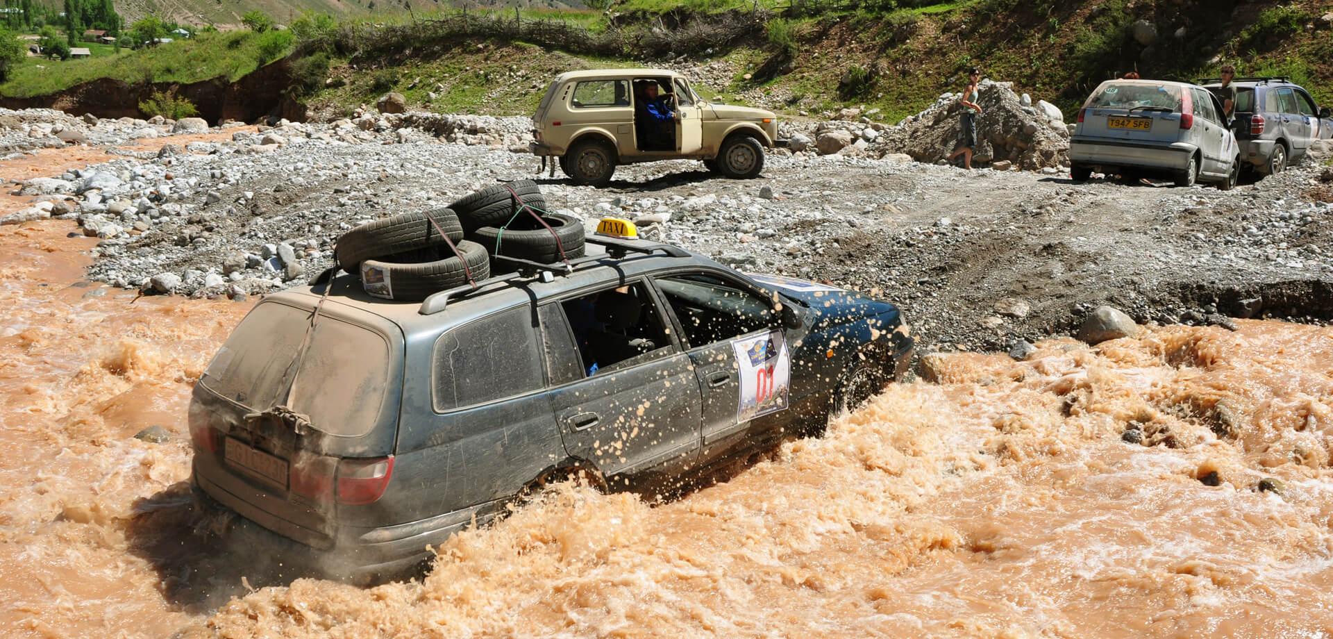 Banger Rally Adventure River crossing in Tajikistan with VW Passat